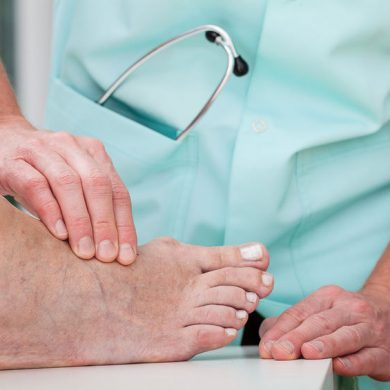 24368946 - a doctor massaging a patient's ill foot